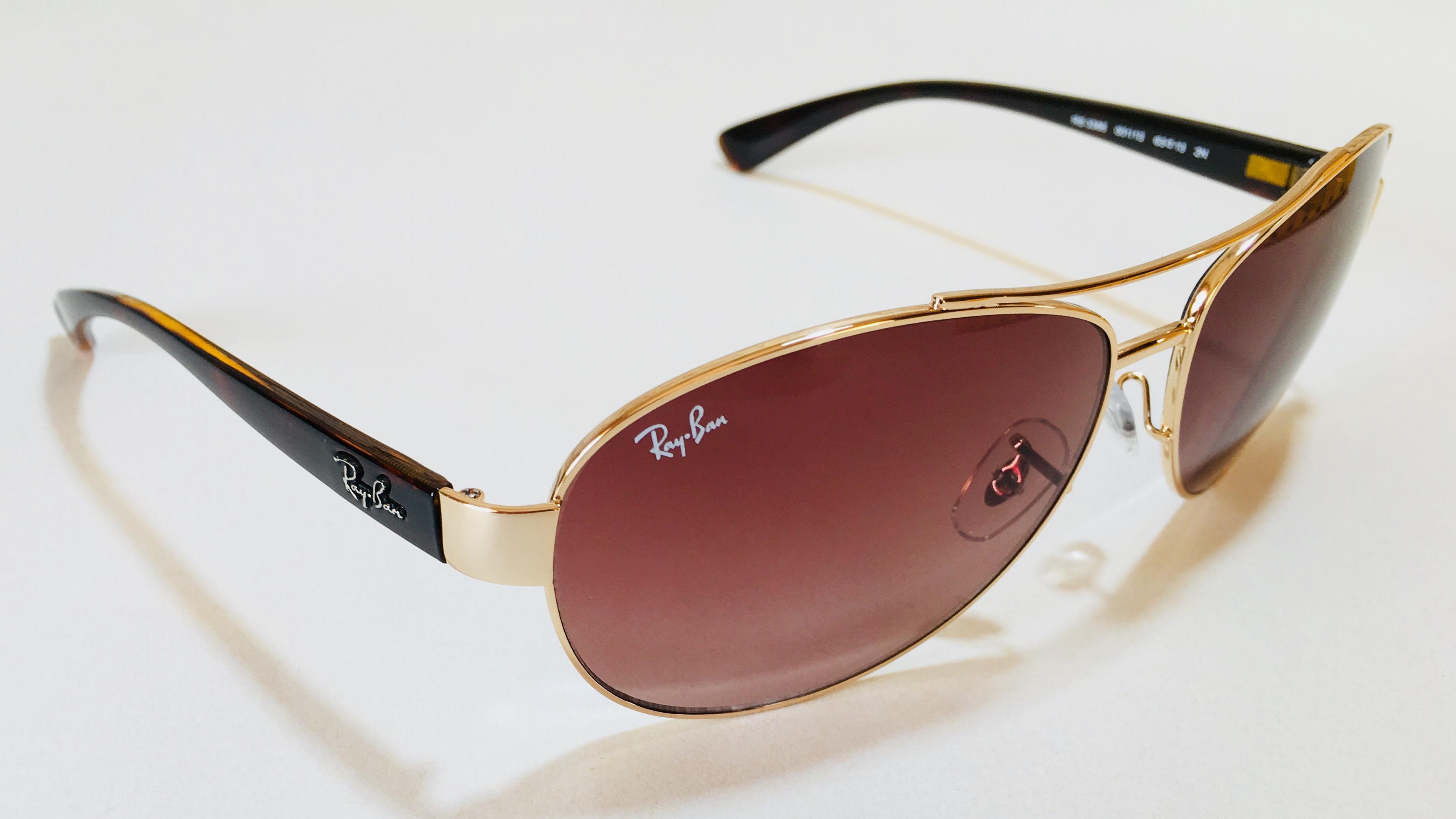 Солнцезащитные очкиРей Бенкупить недорого