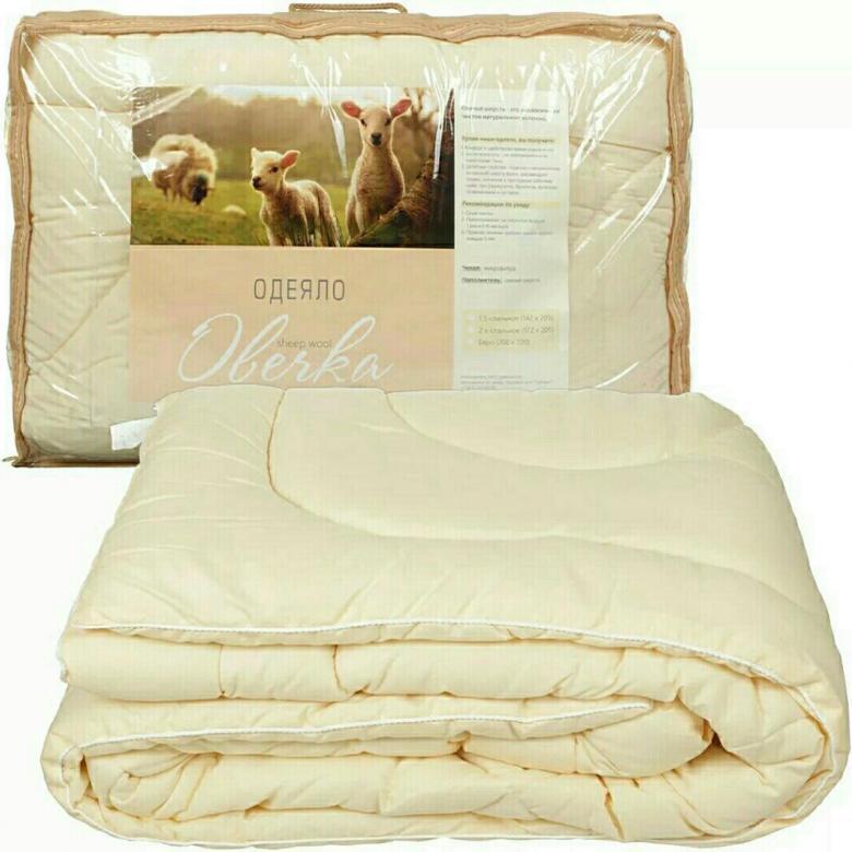 Теплу ковдру з овечої вовни купити