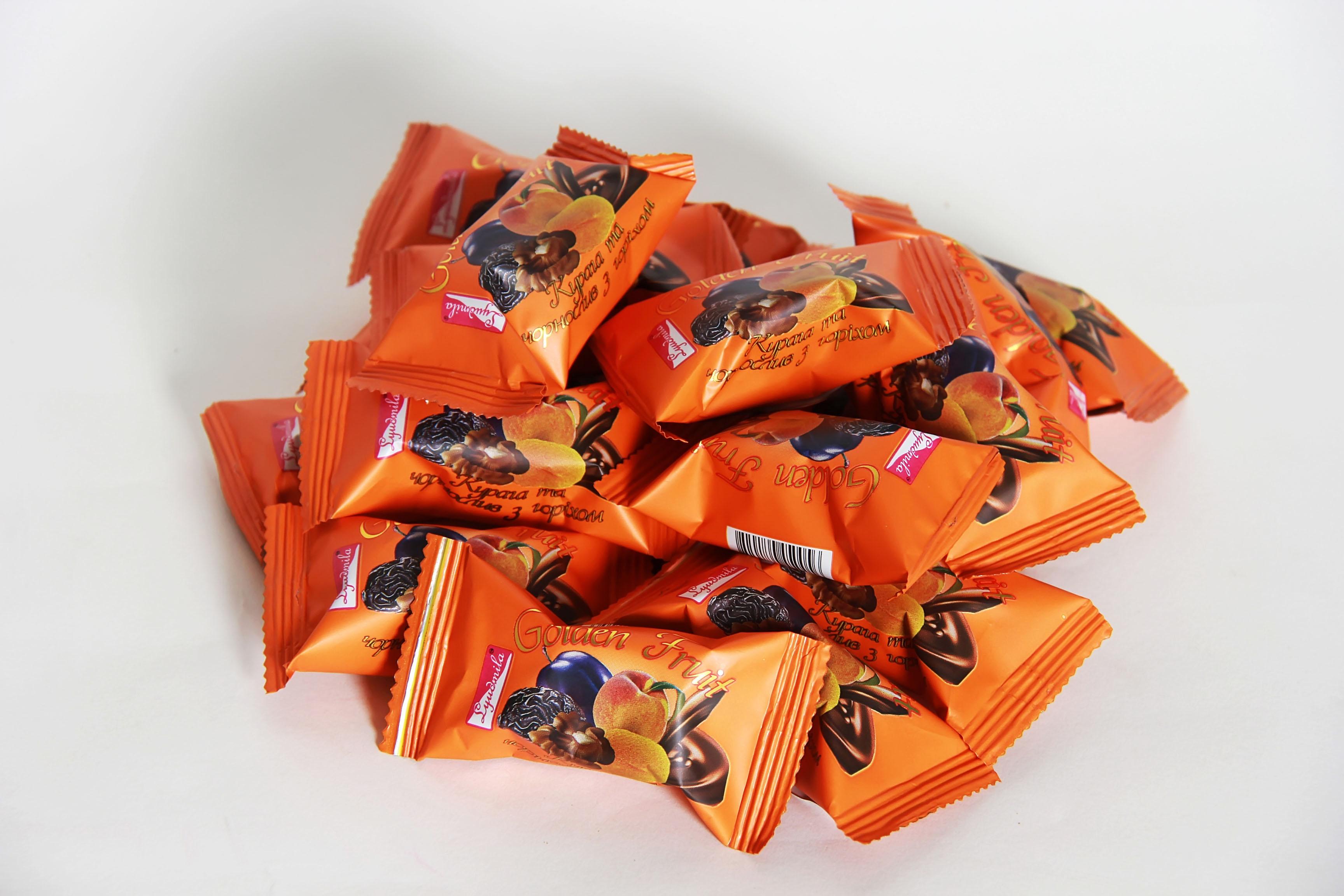Цукерки курага чорнослив з горіхом в шоколаді оптом