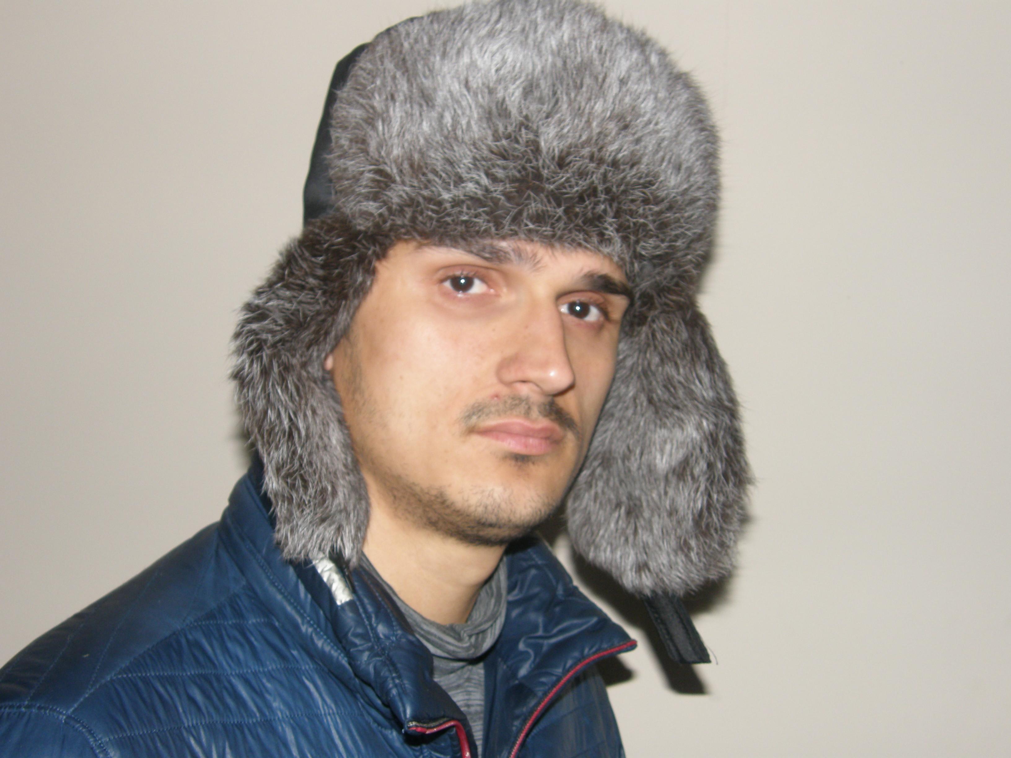 1. Чоловіча хутряна шапка з кролика (сіра) ціна 9f062db9fd3cb