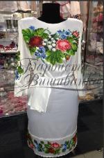 Продається ніжне жіноче плаття, вишивка бісером на атласі