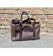 Недорого купити чоловічу шкіряну дорожню сумку можна у нашому інтернет-магазині!