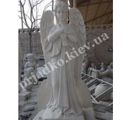 Статуя мраморного ангела с голубем