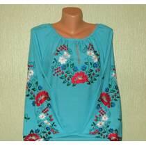 вышитая  женская блуза из голубой ткани