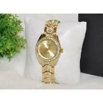 Женские часы Ролекс со стразами золотистые.