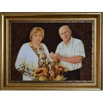 Бурштиновий портрет сімейної пари