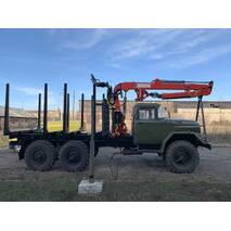 ЗІЛ 131 із установленим кран маніпулятором і обладнанням для перевезення лісу