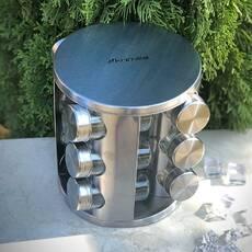 Набір місткостей для спецій на круглій металевій підставці для сервіровки столу
