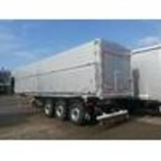 3-х вісний напівпричіп з алюмінієвим кузовом та сталевою рамою, з вивантаженням наліво/назад для міжнародних перевезень (TIR)
