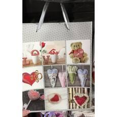 Пакет подарунковий в асортименті кольорів