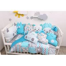 Комплект в ліжечко з іграшками і хмарками у блакитному кольорі
