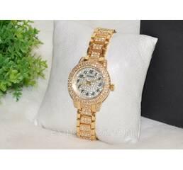 Женские часы Guess золотистые.