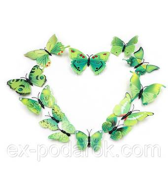 Зелені метелики для декору.