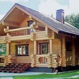 Дерев'яні будинки з оциліндрованих колодзамовити недорого