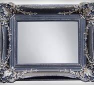 Дзеркало в декоративній рамі з гіпсу