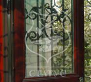 Решетки на двери фигурной ковки