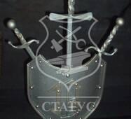 Кований щит з мечами