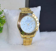 Мужские часы Rolex золотистые.