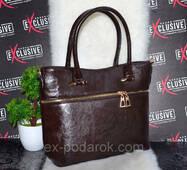 Красива жіноча сумка з декором блискавка.