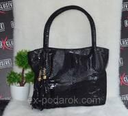Шикарнаячерная сумка для женщин.