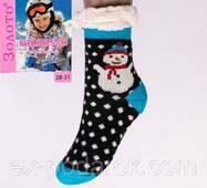 Детские теплые домашние полушерстяные тапочки-носки с антискользящей поверхностью со снеговиком.