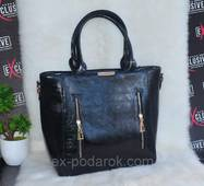 Красивая женская черная сумка.