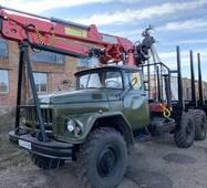 ЗИЛ 131 с установленным кран манипулятором и оборудованием для перевозки леса