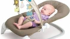 Шезлонг для заколисування дитини: види та особливості