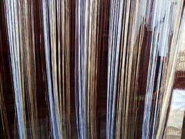Занавіски з ниток та намистин