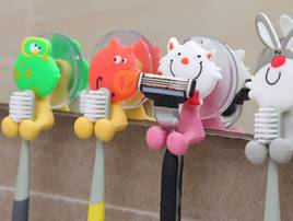 Тримачі для зубних щіток
